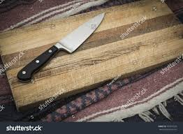 wooden knife on grainy old fashioned stock photo 701877529