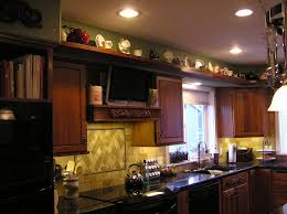 decorating ideas for kitchen cabinet tops best top of kitchen cabinet decorating ideas photos liltigertoo