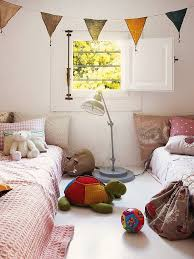 beds on the floor and flag garland create a happy kid u0027s room
