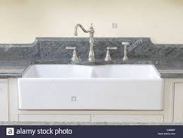 double french farmhouse sink with the ceramic front exposed and