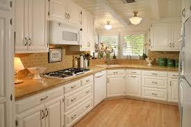 kitchen light wooden cabinet glass ceramic tile backsplash