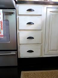 shabby chic distressed kitchen cabinets with arch