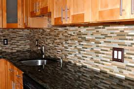installing glass tile backsplash in kitchen black granite countertop and decorative glass mosaic tile backsplash