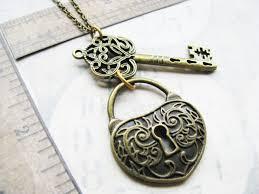 key shaped necklace images Filigree skeleton key and padlock steampunk necklace key hole jpg