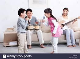 asian family singing karaoke stock photo royalty free image
