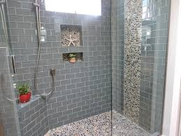 gray glass tile shower room with mosaic stone accent built in wall