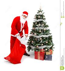 santa claus putting gifts under christmas tree royalty free stock