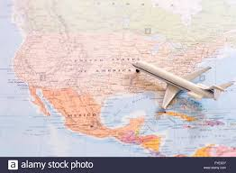 The Map Of United States Of America by Miniature Of A Passenger Plane Flying On The Map Of United States