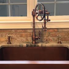 waterstone wheel faucet in antique copper goes great with the waterstone wheel faucet in antique copper goes great with the copper sink