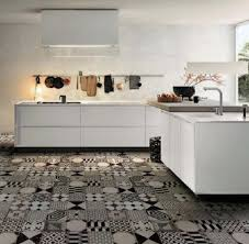contemporary kitchen with white cabinets and patchwork tiles