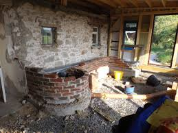 rocket mass heater lackan cottage farm permaculture off grid