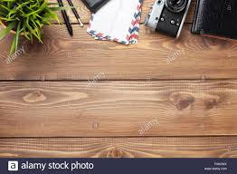 Office Desk Top View Camera And Supplies On Office Wooden Desk Table Top View With