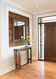 alcove or niche in entryway wall clad in stained shiplap wood