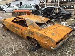 burnt orange camaro is selling this completely burnt to a crisp 1969 camaro z 28 for