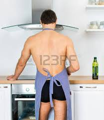 wearing apron in the kitchen stock photo picture and royalty