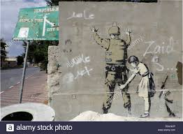 banksy wall stock photos banksy wall stock images alamy wall with a graffito by banksy palestinian side between bethlehem west bank and