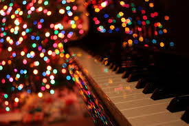 a piano and christmas lights on we heart it