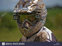 motocross racing man with crash helmet involved in motocross racing with his helmet