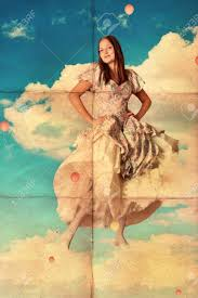 beauty young woman in pretty dress on clouds vintage stock photo