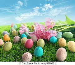 pink easter eggs easter eggs with pink tulips on grass with blue sky stock