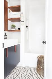 20 bathroom trends that will be huge in 2017 brit co minimalist cabinets with bold tile patterns colorful wallpaper and quirky light fixtures playing a key role in bathroom decor it s important to keep