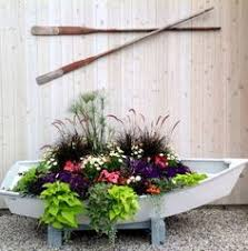 awesome porch and garden planters with a coastal theme boat
