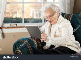 grandma using tablet pc living room stock photo 92173852