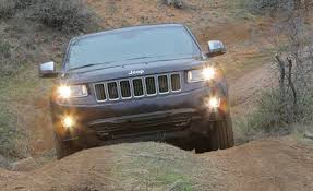 jeep grand cherokee limited 2014 2014 jeep grand cherokee v 6 v 8 first drive review car and driver