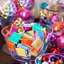 arrange colourfully wrapped chocolates and tree baubles in