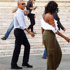 michelle obama steps out in flirty shoulder baring top in tuscany