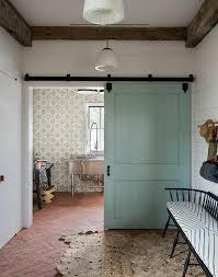 crochet rug on red herringbone floor cottage laundry room