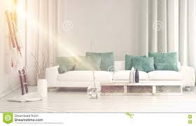 wide sofa in front bathed in yellow sunlight stock photo image