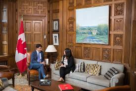 prime minister justin trudeau shows that girlsbelonghere by