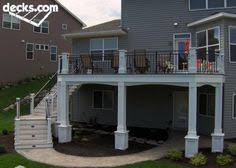 second story deck with curved around stairs with in stairs
