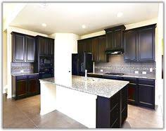 Espresso Kitchen Cabinets by Gourmet Kitchen Features Colonial White Granite Espresso Maple