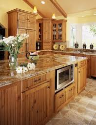 yellow kitchen wood cabinets a large country kitchen with knotty alder cabinets kitchen