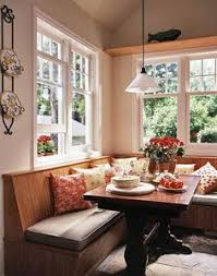 pretty banquet style seating with farmhouse table dining room