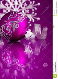 purple and silver christmas ornaments on dark purple background