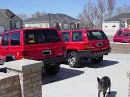 jeep grand cherokee mudding red jeep club lifted red jeep pictures bumper hoop grille guards