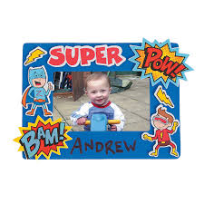 superhero picture frame take picture of kids in superhero backdrop