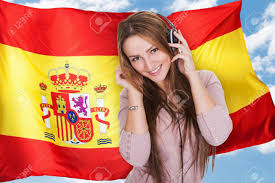 Flags In Spanish Woman Listening Music On Headphones In Front Of Spanish Flag Stock