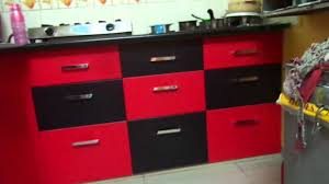 red and black colour modular kitchen baroda ritesh boghani