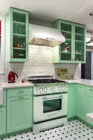bright pastel blue refrigerator and electric range mosaic