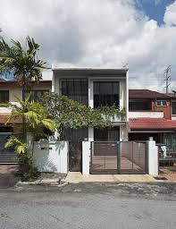 Discreet modern terrace house exterior hides a stunning interior