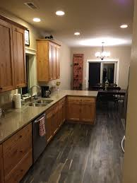 kentwood iron oak springs floors with knotty alder cabinets and