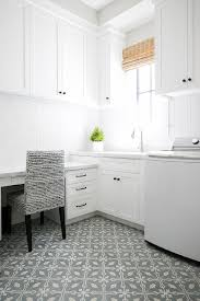 white laundry room with gray cement floor tiles transitional