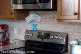 stone backsplash for kitchen installing a split face travertine backsplash pretty handy