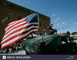 Flag Corps An American Flag Flaps In The Breeze As Local Medal Of Honor Stock