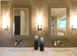 modern bathroom with square wall sconces and vessel sink soapp