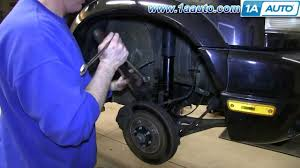 how to install replace front shock strut 2001 06 suzuki xl 7 youtube